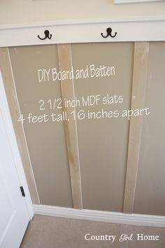COUNTRY GIRL HOME : Bathroom board and batten wall with towell hooks