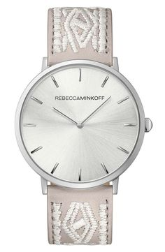 Swooning over this Rebecca Minkoff watch that has a minimalist dial and an embellished leather strap.