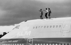 Pilot and two flight attendants dancing on the roof of their KLM Boeing 747-400 in Guatemala.