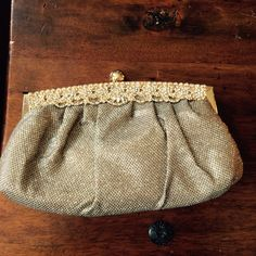 Gold clutch handbag Gold mesh with crystal encrusted evening handbag.  Snaps closed with gold ball.  Satin lining.  Used twice. Bags Clutches & Wristlets