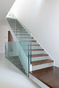 Photo about Wooden stairs with glass balustrade in modern interior and white epoxy flooring. Image of stairs, entrance, light - 46303342 Attic Renovation, Attic Remodel, Floating Staircase, Attic Staircase, Attic Ladder, Staircases, Staircase Handrail, Attic Loft, Modern Staircase