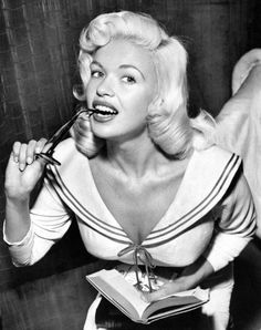 Full, rounded curls brought a bouncy vibe to blonde bombshell locks like Jayne Mansfield's.
