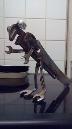 Dinosaur spanner wrench scrap metal sculpture yard art mancave workshop