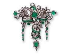 An Antique Emerald and Diamond Brooch, Foliate design featuring emeralds and old mine-cut diamonds. set in silver 18k and 14k gold. circa mid 19th century.