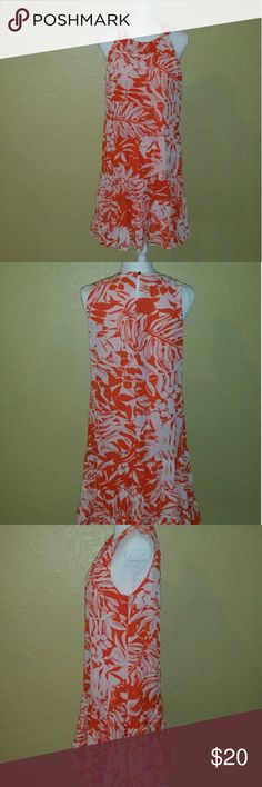 Spring dress Hello southern belles. Do you need the perfect tea party dress. Coral and white floral print dress. Size large. Fits great light and airy but not see thru. Effortless wrinkle free material. Covington Dresses Maxi
