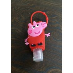 The Piggy Hand Sanitizer with a strap to fasten it onto your belts