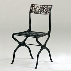 GARDEN CHAIR - SCHINKEL - GERMANY - 1835: Cast iron chair which was one of the first real mass production of furniture in a large scale and early heavy industry, thanks to the use of few molds in which cast iron was poured and solidified quickly. Wrought-iron rods of the seat are the same as the strecher between the legs, riveted from the outside, thus enabling the use of only one mold. The same casting mold was used for both side pieces structure.