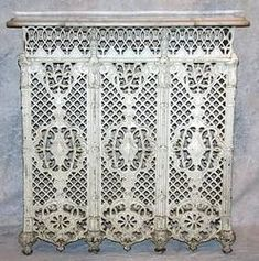 Victorian cast iron radiator cover with white marble top, painted white, circa to 37 Condition: loss to upper left side. Victorian Radiators, Victorian Furniture, Radiator Screen, Radiator Cover, Vintage Stoves, Cast Iron Radiators, Marble Top, Honed Marble, White Marble