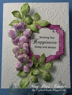 Beautiful Embossing Folder Design accented with Die Cut sentiment and hand-made flowers.