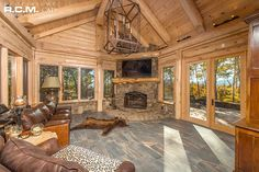 """#TBT A finished project we designed, the """"Tennessee"""" Floor Plan. A beautiful late wood finish on the logs and stunning architectural features. #loghomedesign #floorplans #dreamhouse"""