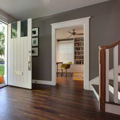 dark floors, grey walls, white trim (eclectic entry by Hugh Jefferson Randolph Architects)