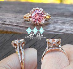 7.5mm Round Brilliant Pink Moissanite Bezel set in a 14K Rose Gold Diamond Scroll Setting