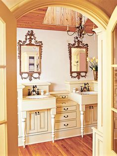 """""""Master Bath"""" --- An arched doorway welcomes you in the master bath. Old world elegance! I love the beautifully crafted mirrors and the vintage-style cabinets! His-and-hers dual sinks are a plus!"""