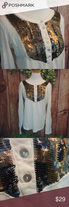 Free People Tiger Eyes Henley Tee A vintage washed cotton henley gets a glamorous accent from a shimmer bib of multi-hued sequins. The material is textured. The front closes by 6 shell looking buttons.  Size Large 100% Cotton 	  Inv # B30 Free People Tops Tees - Long Sleeve