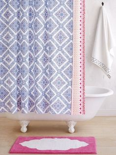 Add vibrant color to the bathroom with this stylish shower curtain in a medallion motif and trimmed in colorful pompoms.