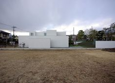 House of Fujinomiya is a minimalist house designed by CASE DESIGN STUDIO.  A garden is placed at the center of the building in order to provide a relationship with greenery at both the front and back of the house. The living space is opened up to the outside overlooking a small rectangular pond. The structure is characterized by white volumes mixed with wooden accents.  http://leibal.com/architecture/house-fujinomiya/