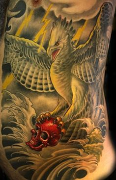 harpy eagle waves lightening weather red skull tattoo by Cory Norris of Grass Valley, CA