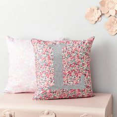 Our personalised Liberty cushion features the letter of your choice in a  gorgeous non-shed glittery script on this stunning pink and coral berry  print.  You can add a stylish personal touch to any room with our personalised  Liberty cushions, or get creative and use the cushions to spell out