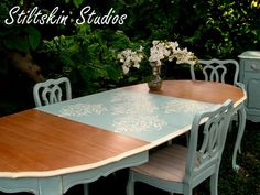 Royal Design Studio's Fabric Damask Dining Table Stencil on table leaf by Stiltskin Studios