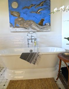 "bathroom with ""Girl by the Sea"" painting by karen bezuidenhout"