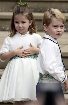 Well-rehearsed roles. Prince George and Princess Charlotte taking their place in the bridal party. Picture: Steve Parsons/Pool via AP