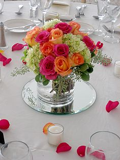 Better with a little bit of lighter pink instead of hot pink and orange roses with green looking flower