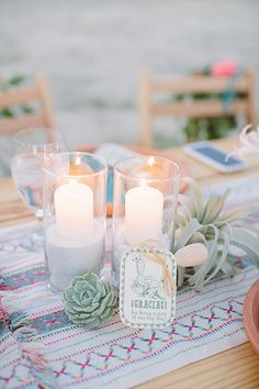 like the candles, succulents, and the pattern on the table runner is great.