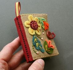 The cutest little needlebook ever:  tutorial http://mmmcrafts.blogspot.com/2011/02/needle-book.html