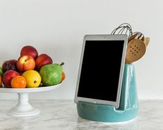 A kitchen tablet dock that not only holds utensils but also an iPad (or cookbook!) so trying out that new recipe will be so much easier for her. 38 Mother's Day Gifts You Basically Can't Go Wrong With Hippie Garden, Sewing Patterns, Crochet Patterns, Quilt Patterns, Pekinese, Kalimba, Earthenware Clay, Shops, Cross Stitch Patterns
