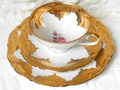 Gorgeous vintage teacup trio with a beautiful gold decoration and a pink rose, on off white porcelain. It was made by Winterling Bavaria, Germany, in the fifties and decorated by LES Porcelaine.   It is in very good condition, no chips or cracks. A rare beauty for your collection!  Please do not put it in the dishwasher!  930  For more vintage teacups visit our shop section: https://www.etsy.com/shop/minoucbrocante?section_id=12193676&ref=shopsection_leftnav_2  For more vintage items please…