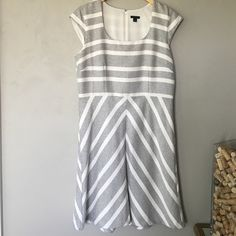 Ann Taylor cap sleeve dress Very light ivory and black boucle, cap sleeve dress in flattering a-line shape. Fully lined. Cotton/Rayon. Perfect condition. Hits at the knee. Ann Taylor Dresses