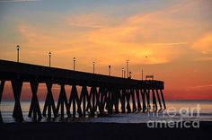 "This beautiful scene of the ""1st Sunrise Of 2015'' was photographed by Bob Sample of PKS Images at Mercers Pier on Wrightsville Beach NC just moments before the sun made it's first appearance of the new year."