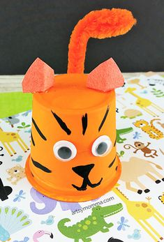 Turn an empty k cup into an adorable Recycled Tiger Craft that kids will think is the cutest thing!