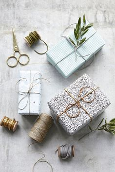 Gold leather string on gift wrap.
