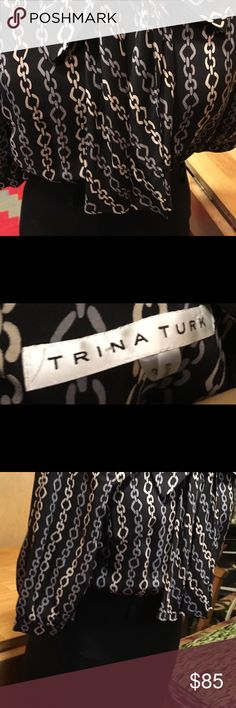Trina Turk Classic Bow and Chain Sophistication! Absolutely perfect. Worn once sophisticated and classy with a twist. Great now forHoliday and office party season. Has bolted area can do thin to over size and can add a little ribbon belt if wanted. Trina Turk Dresses Midi