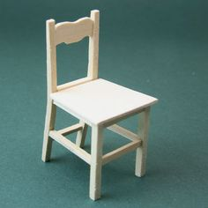 An easy to make simple wooden kitchen chair in 1:12 dolls house scale.