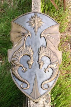 This is very much the kind of artwork one would find in Adelfia, particularly in the capital city, Farindel. A shield decorated with a relief of the Avelin - perfect!