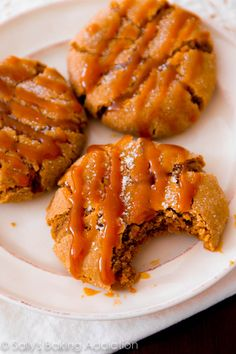 Soft-baked molasses crinkle cookies with a generous drizzle of caramel on top.
