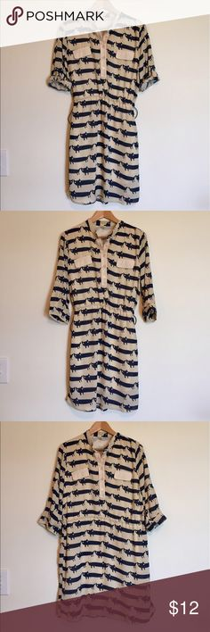 """Cat patterned, drawstring waist dress Navy and cream cat patterned dress. It can be worn with the waist natural, or tied in however much you'd like. Sleeves can also be worn down or rolled up. Fully lined. Size is China XL, but I believe it would best fit a US medium. Length: 35"""", bust: 18.5"""", waist: 19"""" max. Dresses Midi"""