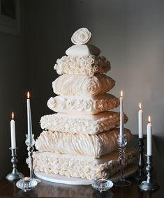 Stunning wedding cake-- like gorgeous pillows! Pair it with perfect wedding hair and makeup: http://vensette.com/bridal_inquiries