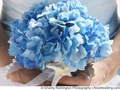 Blue Hydrangea bouquet with starfish detail for a beach wedding.