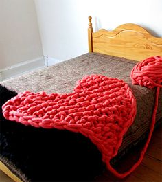 Free Knitting Pattern for Arm Knit Heart Rug or Afghan - Stacy King's creative heart afghan design would make a great gift or decoration for babies, weddings, Valentine's Day, or anyone who needs a little more love!