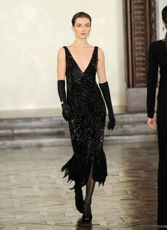 In the Ralph Lauren Runway 2012 collection it is easy to see how contemporary fashion takes inspiration from the past. The design depicted here takes inspiration from the 1920's. The v-neckline, beading, and mid calf hem length were seen in the 1920's. 4/5/15