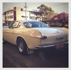 The Volvo P1800 sports car, probably best known for its roll in the 1960′s British television series The Saint, made its debut in 1961. The early models in the series featured these very pleasing upward, rear fins as pictured here.