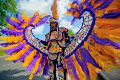 Geronimo Hunters Spy Boy Kevin Wallace parades on Simon Bolivar Ave.