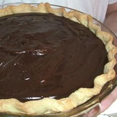 There 's chocolate chips, squares of unsweetened chocolate, and lots of eggs and milk in this creamy, rich pie. The filling is cooked up until thick and lovely and poured into a baked pie shell. It can be made two days in advance. Chocolate Pie Recipes, Chocolate Pies, Chocolate Cream, Chocolate Pudding, Vegetarian Chocolate, Chocolate Custard, Melted Chocolate, Delicious Chocolate, Strawberry Cake From Scratch