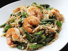 Skillet shrimp with orzo, feta, and asparagus. I would definitely use the suggestion to add grape tomatoes.