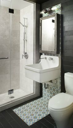 vintage industrial bathroom design. modern white and grey, with a punch of eclectic behind the sink.