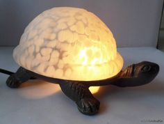 a very nice and cute vintage Meyda Tiffany turtle lamp, turtle light with a white speckled slag glass shell and a cast iron body. Makes a brilliant gift or a samrt looking accessory for yourself!  by SoVintastic, €30.00