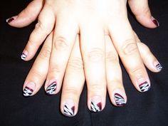 Animal print nail art.